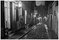 Picturesque cobblestone street on rainy night, Beacon Hill. Boston, Massachussets, USA ( black and white)