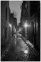 Dark alley on rainy night, Beacon Hill. Boston, Massachussets, USA (black and white)