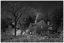 Orchard House at night with smoking chimney, Concord. Massachussets, USA ( black and white)