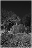 Louisa May Alcott Orchard House at night. Massachussets, USA (black and white)