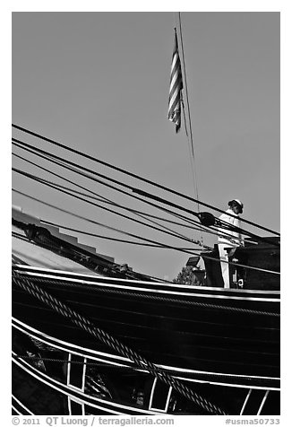 Sailor and flag on USS Constitution (9/11 10th anniversary). Boston, Massachussets, USA (black and white)