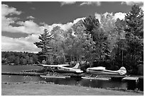 Floatplanes and fall foliage on Moosehead Lake, Greenville. Maine, USA (black and white)