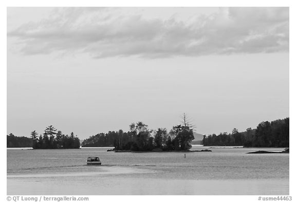 Motorboat and islets at sunset,  Moosehead Lake, Greenville. Maine, USA (black and white)