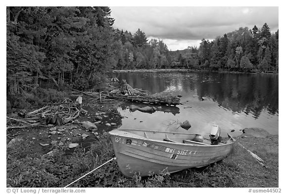 Cove and boat on shore of  Moosehead lake, Lily Bay State Park. Maine, USA (black and white)