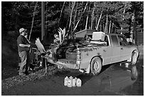 Hunters with moose in back of truck. Maine, USA ( black and white)