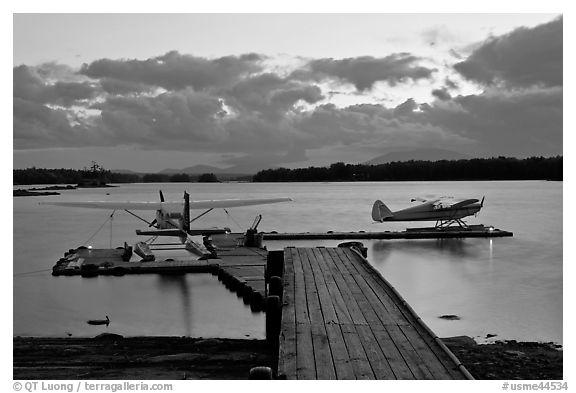 Seaplanes and dock at dusk, Ambajejus Lake. Maine, USA (black and white)