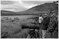 Wildlife photographers on observation platform, Sandy Stream Pond. Baxter State Park, Maine, USA (black and white)
