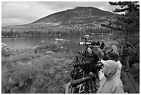 Photographers waiting for moose, Sandy Stream Pond. Baxter State Park, Maine, USA (black and white)