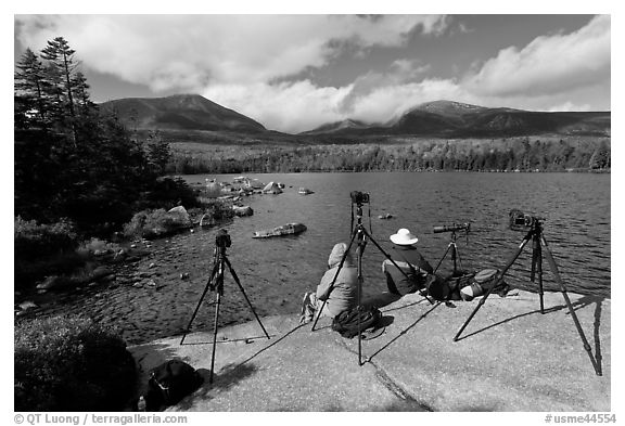 Photographers at Sandy Stream Pond waiting with cameras set up. Baxter State Park, Maine, USA (black and white)