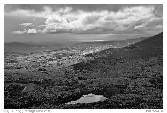 View with storm light and clouds over slopes covered with fall foliage. Baxter State Park, Maine, USA (black and white)