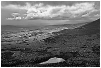 View with storm light and clouds over slopes covered with fall foliage. Baxter State Park, Maine, USA ( black and white)