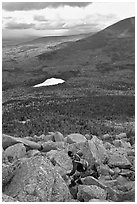 Hiker descends from summit amongst boulders above treeline. Baxter State Park, Maine, USA ( black and white)