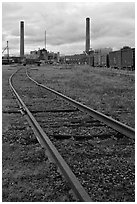 Railroad tracks and smokestacks, Millinocket. Maine, USA (black and white)