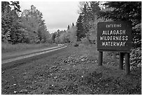 Road with Allagash wilderness sign. Allagash Wilderness Waterway, Maine, USA (black and white)