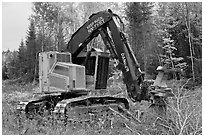 Tracked forest harvester. Maine, USA (black and white)