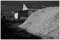 Sawdust in lumber mill at night, Ashland. Maine, USA ( black and white)