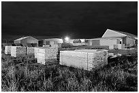 Lumber stacks at night, Ashland. Maine, USA (black and white)