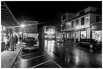Street at night with people standing on sidewalk. Bar Harbor, Maine, USA (black and white)