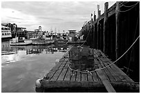 Lobster traps and fishing boats below pier. Portland, Maine, USA ( black and white)