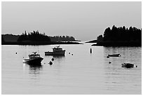 Boats and Penobscot Bay islets, sunrise. Stonington, Maine, USA ( black and white)