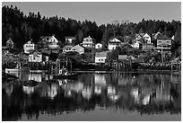 Reflection of hillside houses. Stonington, Maine, USA (black and white)