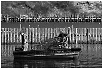 Lobstermen hauling traps. Stonington, Maine, USA (black and white)