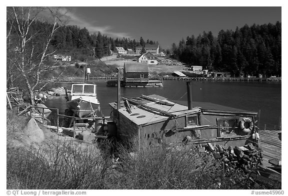 Old schack and harbor. Stonington, Maine, USA (black and white)