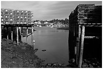 Lobster traps framing harbor. Corea, Maine, USA (black and white)