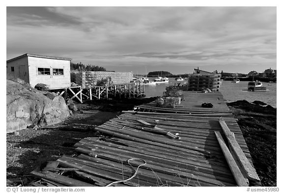 Deck, lobster traps, and harbor. Corea, Maine, USA (black and white)