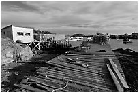 Deck, lobster traps, and harbor. Corea, Maine, USA ( black and white)