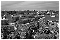 Lobster traps and village. Corea, Maine, USA (black and white)