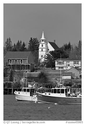 Lobster boats and village church. Corea, Maine, USA (black and white)