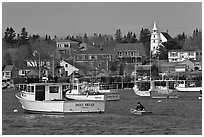 Lobsterman paddling towards boat. Corea, Maine, USA ( black and white)