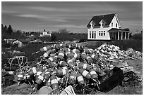 Buoys and house. Corea, Maine, USA ( black and white)