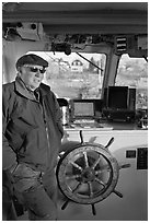 Captain of Isle-au-Haut mailboat aboard boat. Isle Au Haut, Maine, USA (black and white)