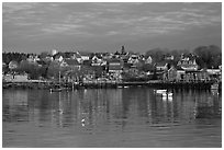 Harber and hillside houses at sunrise. Stonington, Maine, USA (black and white)