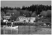 Men on small boat in harbor. Stonington, Maine, USA (black and white)