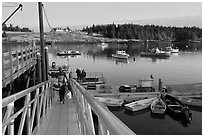 Passengers headed towards mailboat. Isle Au Haut, Maine, USA (black and white)