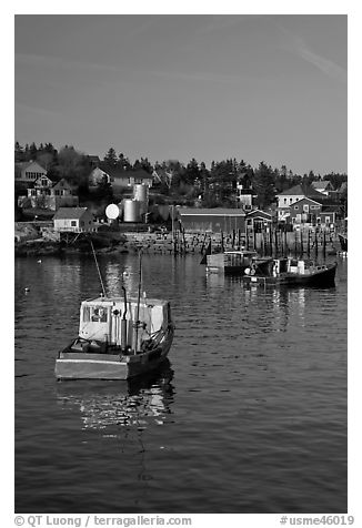 Traditional lobster boats and houses, late afternoon. Stonington, Maine, USA (black and white)