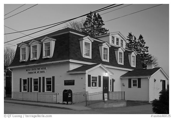 Post office in federal style at dusk. Stonington, Maine, USA (black and white)