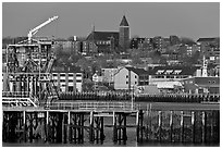 Pier and hillside buildings across harbor. Portland, Maine, USA ( black and white)