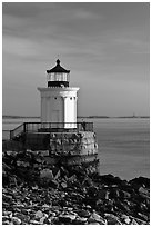 Bug Light with boy running. Portland, Maine, USA ( black and white)
