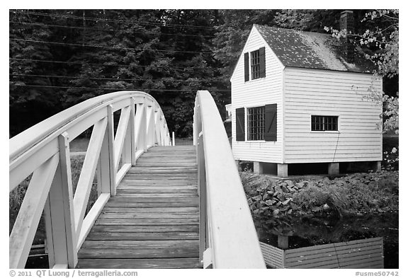 Wooden arched footbridge and house. Maine, USA (black and white)