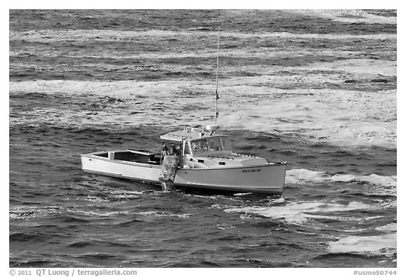 Fishermen on lobster boat. Bar Harbor, Maine, USA (black and white)