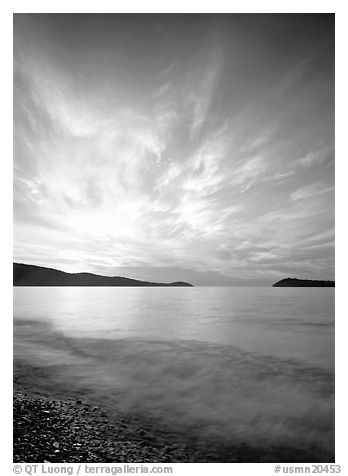 Clouds, surf, and islands near Grand Portage, sunrise. Minnesota, USA (black and white)