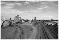 Railroad, grain elevator, and fertilizer plant, Bowman. North Dakota, USA (black and white)