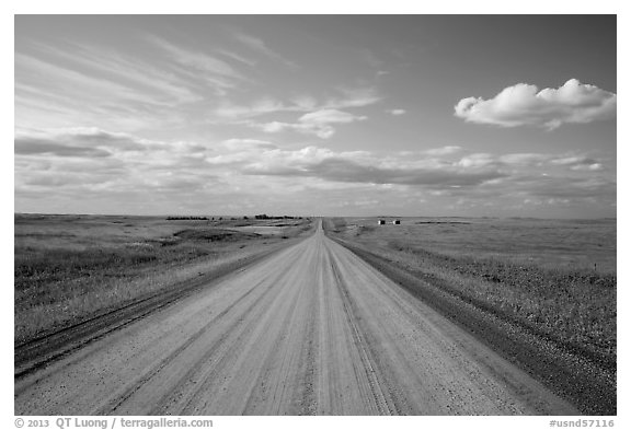 Gravel road in open prairie. North Dakota, USA (black and white)