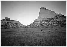 Scotts Bluff, Mitchell Pass, and South Bluff with the warm light of sunrise. Scotts Bluff National Monument. South Dakota, USA (black and white)