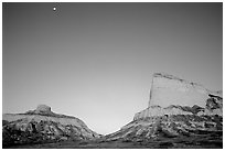 Scotts Bluff, Mitchell Pass, and  South Bluff at sunrise with moon. Scotts Bluff National Monument. Nebraska, USA (black and white)