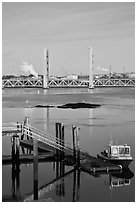 Small baot Bridges over Portsmouth river estuary. Portsmouth, New Hampshire, USA ( black and white)